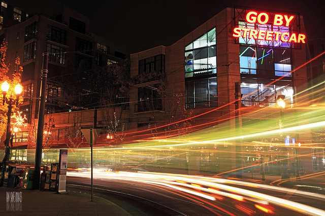 "The ""Go By Streetcar"" sign lights up the night in Portland's The Pearl District."